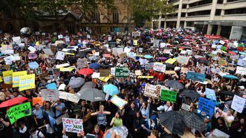 Thousands of school students from across Sydney pack into Town Hall square.