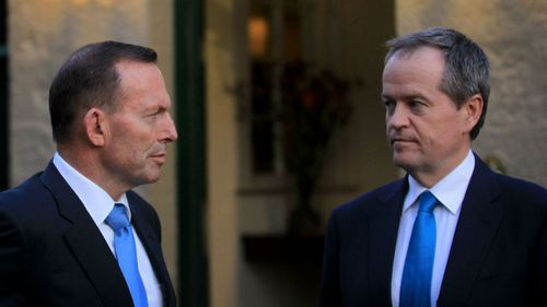 Tony Abbott and Bill Shorten - now set to be on the same side when it comes to asylum seekers. (AAP)