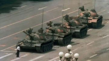 An unidentified person known as 'tank man' stands before tanks in China's Tiananmen Square during pro-democracy demonstrations in June 1989 in one of the most enduring images of the conflict.