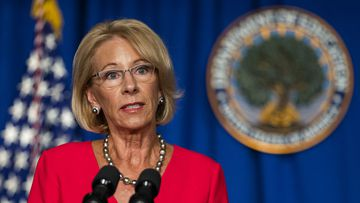 Education Secretary Betsy Devos described Donald Trump's rhetoric as an 'inflection point' in her resignation decision.
