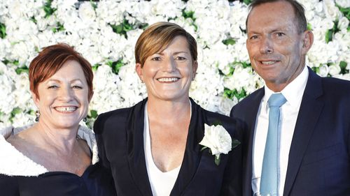 Tony Abbott with his sister Christine Forster and her wife Virginia Edwards. Ms Forster is expected to run in the seat. (AAP)