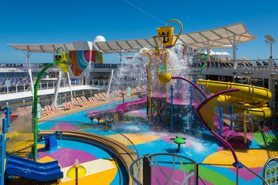 The outdoor pool area also features a children's water park.