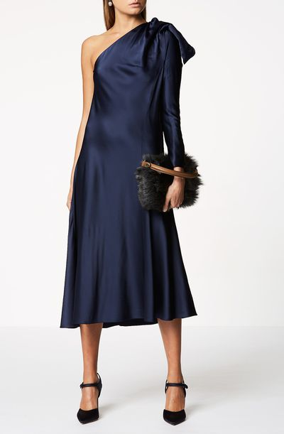 """<a href=""""https://www.scanlantheodore.com/collections/dresses/products/satin-draped-shoulder-dress"""" target=""""_blank"""" draggable=""""false"""">Scanlan Theodore Satin Draped Shoulder Dress in Dark Navy, $650</a>"""