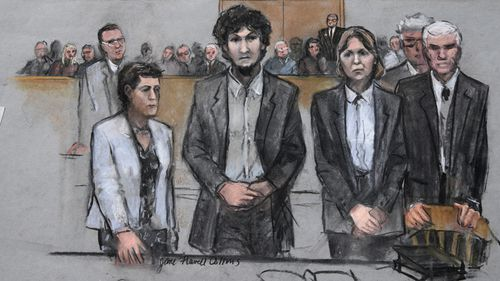 A 2015 court sketch of Boston Marathon bomber Dzhokhar Tsarnaev, center, with his defence attorneys at the Moakley Federal court house.