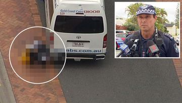 A Queensland baby has been killed by a reversing taxi outside his home.