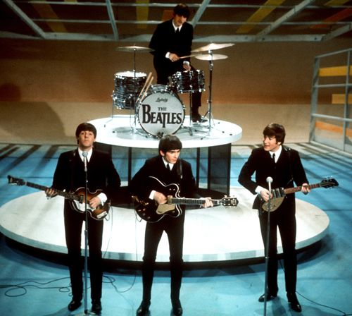 The Beatles perform on the CBS Ed Sullivan Show in New York. (AAP)