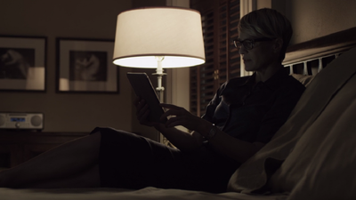 We get a glimpse of a more relaxed Claire working in bed with chic glasses and a steely resolve.