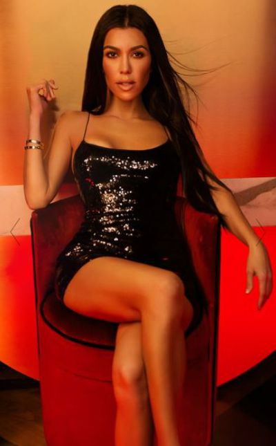 "<a href=""https://www.prettylittlething.com.au/black-strappy-sequin-bodycon-dress.html"" target=""_blank"">Black strappy sequin bodycon dress, $60.</a>"