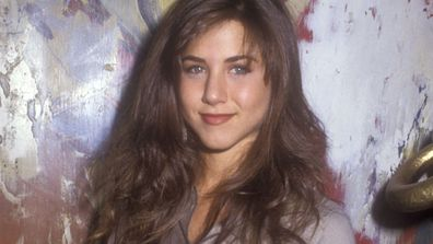 "Before she sported the more flattering ""Rachel cut"" on <i>Friends</i>, Jennifer Aniston had seriously mousey brown hair."
