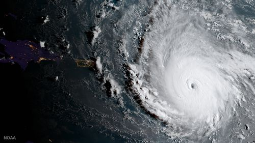 In this geocolor image captured by GOES-16 and released by the National Oceanic and Atmospheric Administration (NOAA), Hurricane Irma, a potentially catastrophic category 5 hurricane, moves westward in the Atlantic Ocean toward the Leeward Islands. (NOAA)