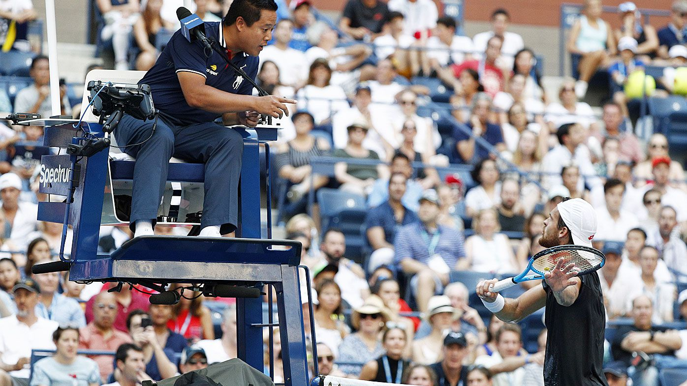 Joao Sousa argues with the chair umpire as he plays Novak Djokovic