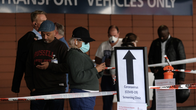 A sign explaining COVID-19 screening procedure is posted outside the Royal Melbourne Hospital on March 11, 2020 in Melbourne, Australia. (Photo by Luis Ascui/Getty Images)