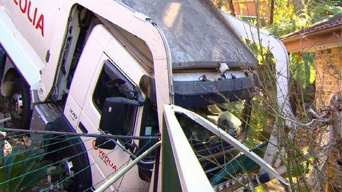 A garbage truck has smashed through a garden in Belrose, Sydney.