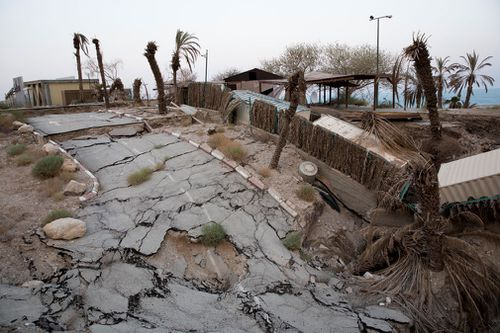 A spa facility, collapsed, due to the withdrawal of the Dead Sea water line.