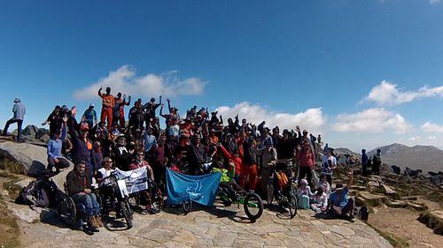 Mountaineer Steve Plain accompanied the children on the 18km Mt Kosciuszko Wheelchair Summit Challenge.