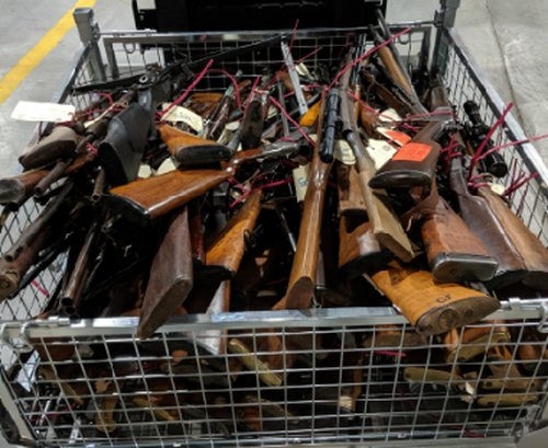 """Police seized weapons including an assault rifle, shotguns, a machine gun, pistols, silencers, crossbows, a dagger, as well as """"flash bang"""" explosives."""