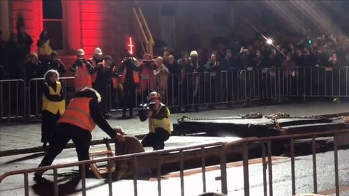 After three days sealed inside a steel container underneath a busy Hobart street, performance artist Mike Parr emerged without saying a word. Picture: 9NEWS