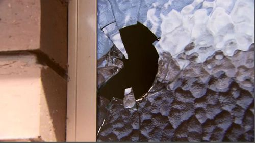Ricocheting bullet went straight through elderly couple's toilet window. (9NEWS)