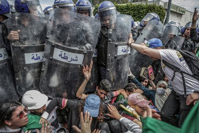 Clash with the Police During an Anti-Government Demonstration by Farouk Batiche