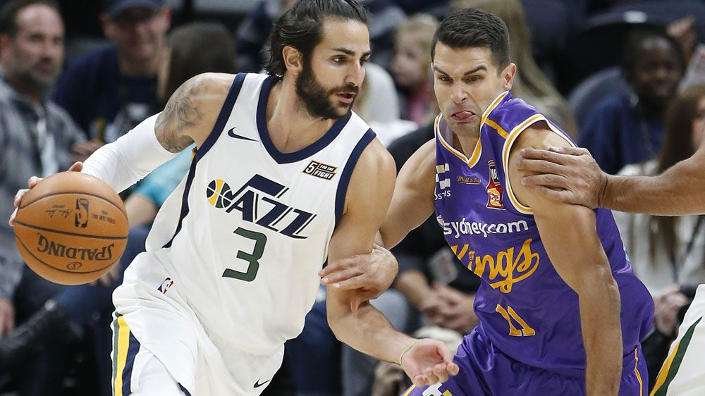 Utah's Ricky Rubio takes on the Kings' Kevin Lisch. (AAP)
