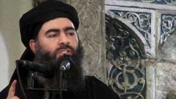 The leader of the Islamic State group, Abu Bakr al-Baghdadi, purportedly delivering a sermon at a mosque in Iraq during his first public appearance. (AAP)