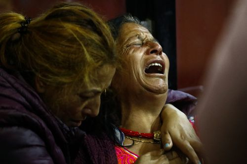 Family members of plane crash victims mourn at the hospital in Kathmandu, Nepal. (AP)