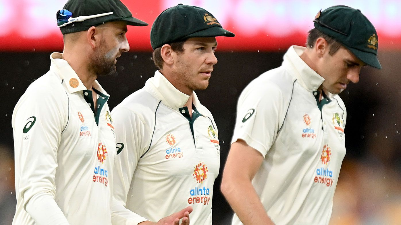 Nathan Lyon, Tim Paine and Pat Cummin during the final day of the fourth Test.