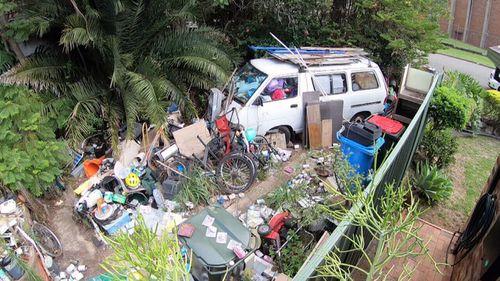 This van in Robert's yard appears to be stuffed full of trash.