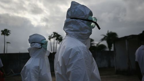 A burial team from the Liberian Ministry of Health prepares to unload the bodies of Ebola victims at a crematorium. (Getty Images)