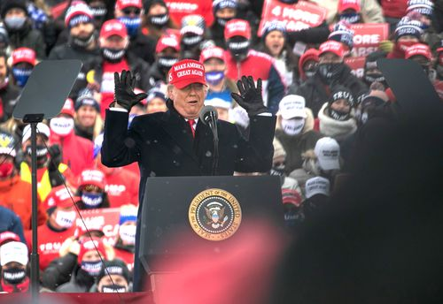 President Donald Trump addresses supporters at a campaign rally in Washington, Michigan.