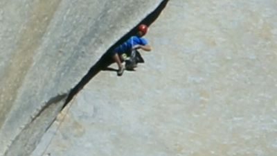 Free climbers use their hands and feet to pull themselves up the rock face, clinging to every nook and cranny. (9NEWS)