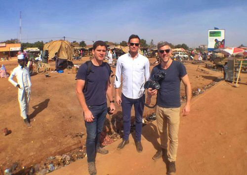 Tom Steinfort with some of the crew in Burkina Faso. (9NEWS)