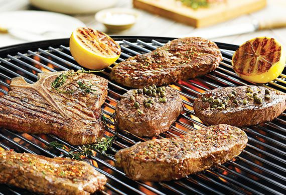 The Honey Badger's barbecued T-bone steaks with herbs and green peppercorns
