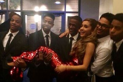 And here she is being carried by her backup dancers like a total baby...because she can.