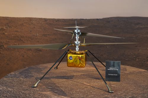 A full-scale model of the Mars Helicopter Ingenuity is displayed for the media at NASA's Jet Propulsion Laboratory (JPL).  (AP Photo/Damian Dovarganes)