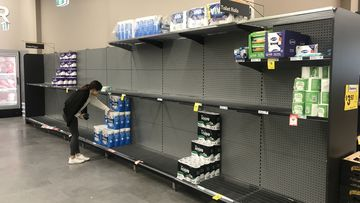 Supermarket shelves in Alexandria stripped of toilet paper.