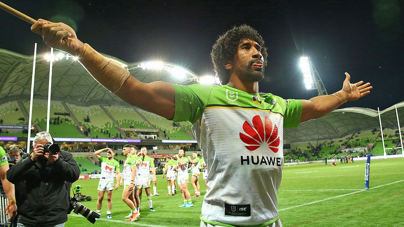The Raiders celebrate defeating Melbourne Storm