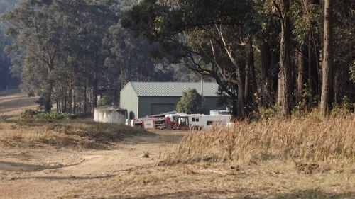 Mr Tull crashed on a private property at Woodstock, near the Kingiman fire which continues to burn west of Ulladulla.