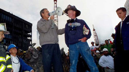 President George W Bush rallies the crowd at the base of the World Trade Centre on September 14, 2001.