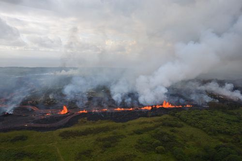An aerial photo released by the US Geological Survey shows lava fountains from Fissure 20 in Kilauea volcano's lower East Rift Zone. (AAP)