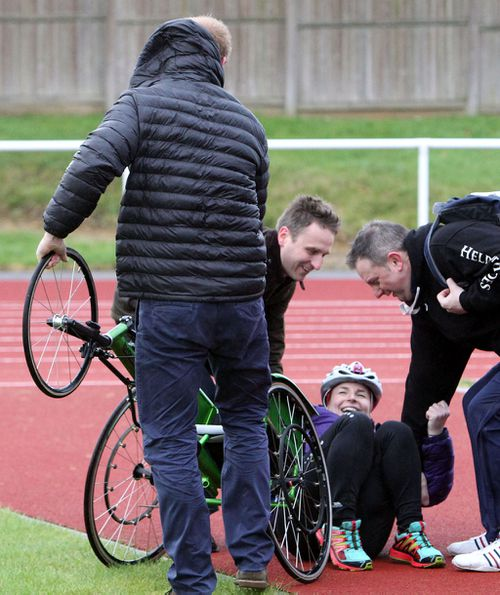 Cyclist Anna Pollock had been chatting with the prince when a gust of wind knocked her from her chair. (AAP)