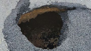 Police warn residents to be wary of sink hole on Murray Street in Gawler in South Australia.