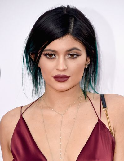 Kylie wears a side part up-do