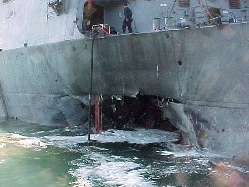 Damage sustained on the USS Cole after a terrorist bomb exploded during a refuelling operation in the port of Aden, Yemen.