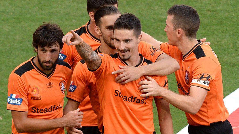 Roar to top of A-League after Glory win
