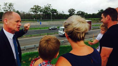 Queensland government promises to spend millions on roads
