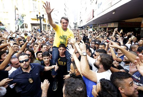 Brazilian presidential candidate Jair Bolsonaro waves to the crowd in Juiz de Fora, 200kms north of Rio.