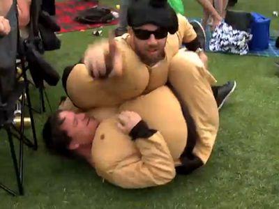 Sumo wrestlers enjoy the day.