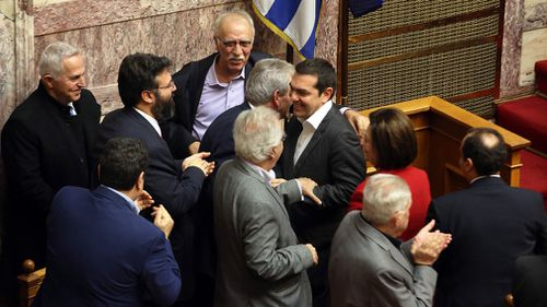 Greek lawmakers ratified an agreement to end a nearly three decade-long dispute over neighbouring Macedonia's name.