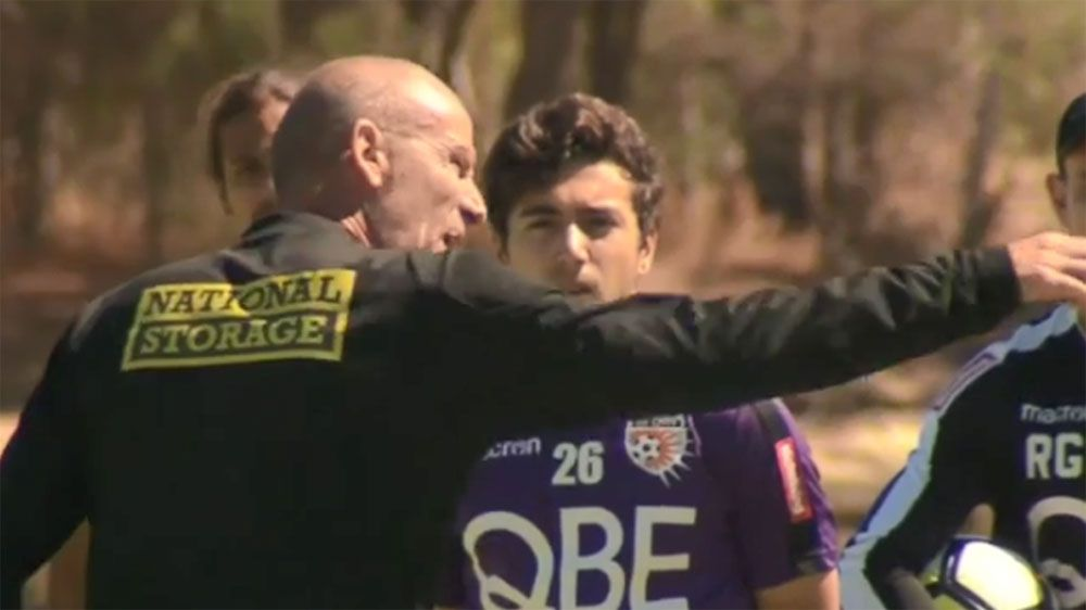 Perth Glory coach Kenny Lowe gives his players an almighty spray in front of cameras at training
